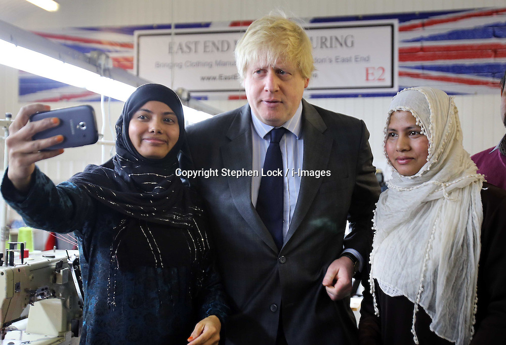 Boris Johnson, Mayor of  London, with machinists  during a visit to  a new clothing factory in the East End of London, Tuesday, 26th February 2013. Photo by: Stephen Lock / i-Images