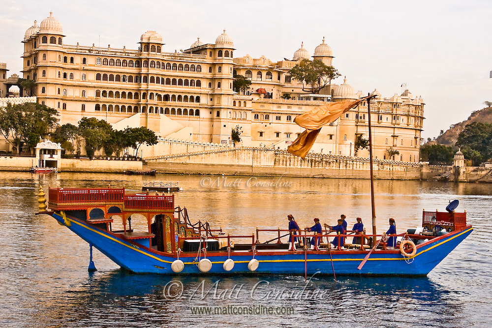 Exterior view of The City Palace, with Royal Barge in the foreground on Lake Pichola.<br /> (Photo by Matt Considine - Images of Asia Collection)