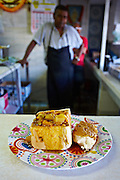 """CREDIT: Albie Bredenhann for The Wall Street Journal.<br /> <br /> """"ISO Bunnychow.OD""""<br /> <br /> Photos taken at Patel's Vegetarian Refreshment House in Durban, South Africa of their signature mixed vegetable and broad bean curry Bunny Chow. Patel's is a small intimate canteen style eatery in downtown Durban right in the middle of the hussle and bustle. Patel's is said to be the birth place of the bunny chow almost 99 years ago when the original owner and father of current owner Manilal Patel, created the hollowed out loaf of bread filled with curry favorite, to serve to black patrons who, in accordance with the laws of the time, could not sit down in the establishments to eat. My Bunny Chow was midly spicy, packed with vegetables and beans and served in a fresh quarter loaf of white bread and soaked in curry, one I would definitely go back for again. Today they serve anything between 400 to 500 Bunny Chows to eager patrons. Their costs range from R12.00 ($1.16) for their small Bunnies to R30.00 ($2.92) for the gigantic half a loaf Bunny filled with their mixed vegetable and broad bean curry, extreme value for money!"""