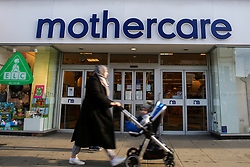 © Licensed to London News Pictures. 04/11/2019. London, UK. A mother with a pram walks past Mothercare branch on Wood Green High Road in north London. <br /> Mothercare - the mother-and-baby retailer and an Early Learning Centre is to appoint administrators for its 79 UK high street stores following lost of £36.3m last year and putting 2,500 jobs at risk. Photo credit: Dinendra Haria/LNP