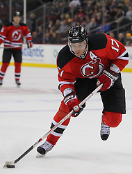 Jan 19; Newark, NJ, USA; New Jersey Devils left wing Ilya Kovalchuk (17) skates with the puck during the second period of their game against the Boston Bruins at the Prudential Center.