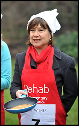 Libby Wiener ITN, takes part in the MP's and Lords race against political Journalist in the Rehab Parliamentary Pancake Shrove Tuesday race a charity event which sees MPs and Lords joined by media types in a race to the finish. Victoria Tower Gardens, Westminster, Tuesday February 12, 2013. Photo By Andrew Parsons / i-Images