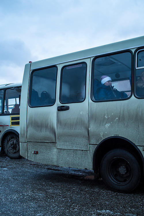 A woman sits on a bus on Saturday, October 26, 2013 in Baikalsk, Russia.