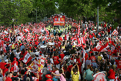 LIVERPOOL, ENGLAND - THURSDAY, MAY 26th, 2005: Liverpool fans cheer as the players parade the European Champions Cup on on open-top bus tour of Liverpool in front of 500,000 fans after beating AC Milan in the UEFA Champions League Final at the Ataturk Olympic Stadium, Istanbul. (Pic by David Rawcliffe/Propaganda)