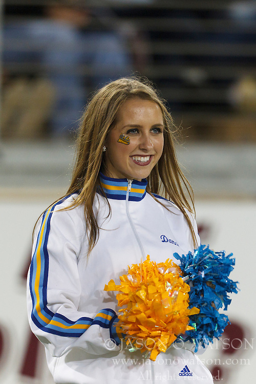Oct 1, 2011; Stanford CA, USA;  A UCLA Bruins cheerleader performs on the sidelines against the Stanford Cardinal during the second quarter at Stanford Stadium. Mandatory Credit: Jason O. Watson-US PRESSWIRE