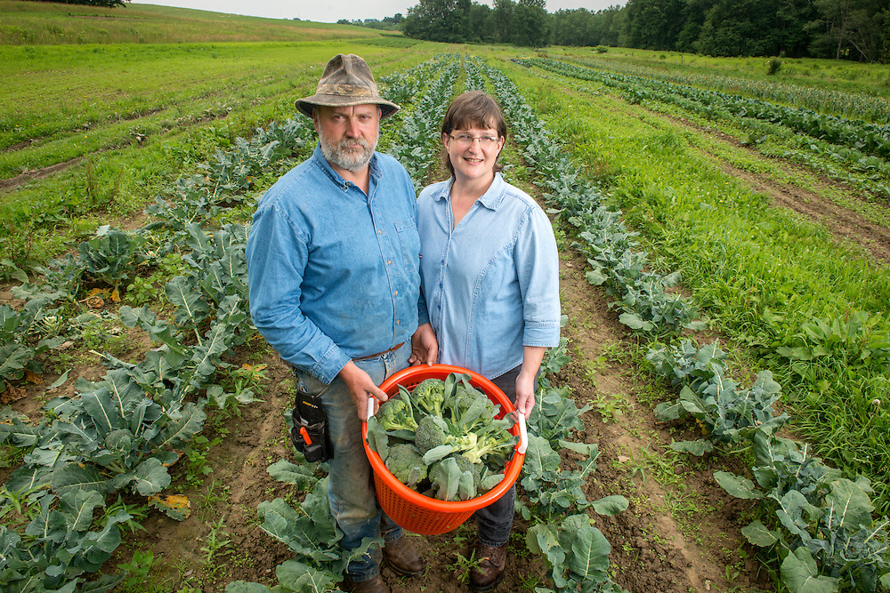 Family of farmers posed in a broccoli field