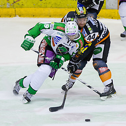 Ziga Pance (HDD Tilia Olimpija, #19) vs Olivier Latendresse (Moser Medical Graz 99ers, #44) during of ice-hockey match between Moser Medical Graz 99ers and HDD Tilia Olimpija in 11th Round of EBEL league, on October 14, 2011 at Eisstadion Graz-Liebenau, Graz, Austria. (Photo By Matic Klansek Velej / Sportida)