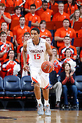 CHARLOTTESVILLE, VA - DECEMBER 4: Malcolm Brogdon #15 of the Virginia Cavaliers handles the ball against the Wisconsin Badgers during the Big Ten/ACC Challenge game at John Paul Jones Arena on December 4, 2013 in Charlottesville, Virginia. Wisconsin won 48-38. (Photo by Joe Robbins) *** Local Caption *** Malcolm Brogdon