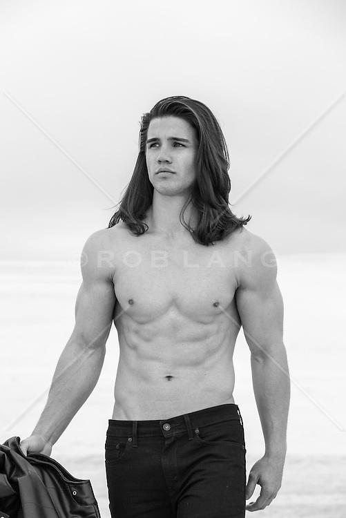 shirtless man with long hair outdoors