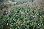 Nederland, Noord-Holland, Hilversum, 15-02-2007; luchtfoto (25 procent toeslag); stacaravans op camping in het bos ten zuiden van Hilversum, zichtbaar tussen de kale winterse bomen; kamperen, recreatie, toerisme, zomerhuisje, dagrecreatie.luchtfoto (toeslag); aerial photo (additional fee required); .foto Siebe Swart / photo Siebe Swart