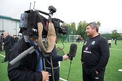 NEWPORT, WALES - Wednesday, July 4, 2012: Wales football coach Osain Williams is interviewed as the Football Association of Wales open the first 3G pitch at the National Development Centre at the Newport International Sports Village. (Pic by David Rawcliffe/Propaganda)