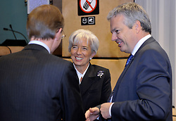 Christine Lagarde, France's finance minister, center, speaks with Luc Frieden, Luxembourg's minister of Finance, left and Didier Reynders, Belgium's finance minister, during Eurogroup, the meeting of finance ministers from the sixteen euro-zone countries,  at EU Council headquarters in Brussels, Belgium, on Monday, Nov. 9, 2009. (Photo © Jock Fistick)