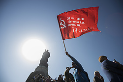 May 9, 2018 - Berlin, Germany - A man waves a soviet red flag to commemorate on the 73rd anniversary of the victory of the Soviet Red Army over Nazi Germany at the Soviet World War II cemetery and memorial in Treptow on May 9, 2018 in Berlin, Germany. (Credit Image: © Emmanuele Contini/NurPhoto via ZUMA Press)