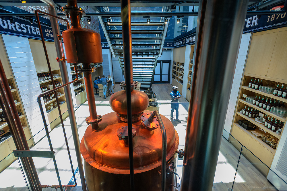 The elevator ride offers a view of the atrium with the gift area at the bottom and the 44 foot-tall column still made by Vendome Copper & Brass Works of Louisville, Ky., in the center of the view in the Old Forester Distilling Company on Whisky Row in Louisville, Ky. June 6, 2018