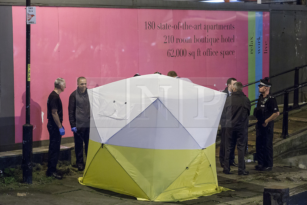 """© Licensed to London News Pictures . Manchester , UK . FILE PICTURE DATED  06/10/2013 of a forensic tent beside the canal , containing a body recovered from the canal . Police pulled a body from The Bridgewater Canal in Manchester , adjacent to the City's """" Gay Village """" on Canal Street . Greater Manchester Police have issued a statement after suggestions that a number of deaths in and around Manchester's canals may be linked to a serial killer , named in local folklore as """" The Pusher """" . The statement said """" Absolutely no evidence whatsoever of foul play has been established """" . Photo credit : Joel Goodman/LNP"""