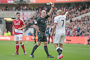 Roger East (Middlesbrough) books Nordin Amrabat (Watford) for the foul on George Friend (Middlesbrough) during the Premier League match between Middlesbrough and Watford at the Riverside Stadium, Middlesbrough, England on 16 October 2016. Photo by Mark P Doherty.