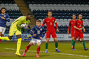 Kai Kennedy (Rangers FC) puts Samuel Soares under pressure during the U17 European Championships match between Portugal and Scotland at Simple Digital Arena, Paisley, Scotland on 20 March 2019.