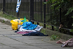 © Licensed to London News Pictures. 26/07/2019. London, UK. Personal belongings lie on the floor at the scene at Boundary Road in South Hampstead, north west London where a man has died and another was injured in a stabbing last night.  Photo credit: Ben Cawthra/LNP