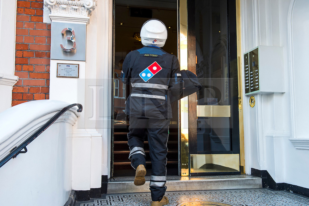 **NAME JULIAN ASSANGE CLEARLY WRITTEN ON LABEL**© Licensed to London News Pictures. 12/10/2015. London, UK. Dominos pizza being delivered to JULIAN ASSANGE at the Ecuadorian Embasy on the day that   metropolitan police have stopped guarding the embassy. Julian Assange has been living at the embassy since failing to surrender to custody on 29, June 2012. Photo credit: Ben Cawthra/LNP