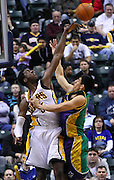 Feb. 21, 2012; Indianapolis, IN, USA; Indiana Pacers center Roy Hibbert (55) goes up to block the shot of New Orleans Hornets power forward Gustavo Ayon (15) at Bankers Life Fieldhouse. Indiana defeated New Orleans 117-108. Mandatory credit: Michael Hickey-US PRESSWIRE