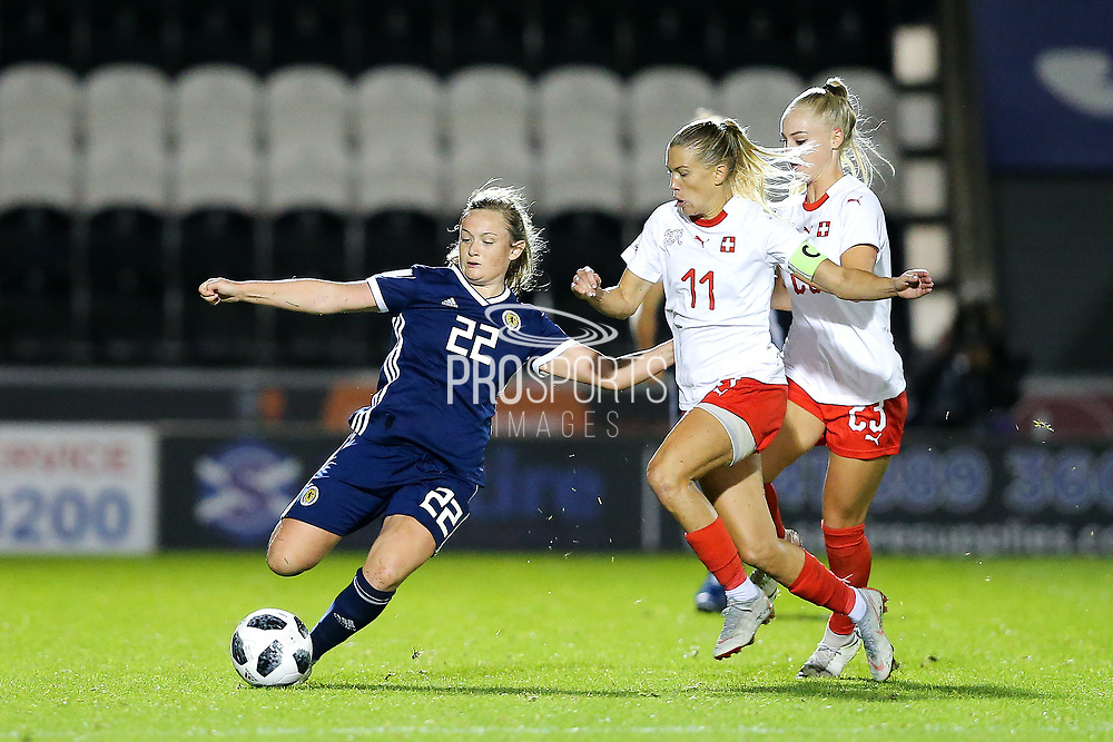 Erin Cuthbert (#22) of Scotland plays a long forward pass under pressure from Lara Dickenmann (#11) of Switzerland during the 2019 FIFA Women's World Cup UEFA Qualifier match between Scotland Women and Switzerland at the Simple Digital Arena, St Mirren, Scotland on 30 August 2018.