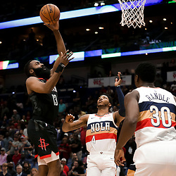 Mar 24, 2019; New Orleans, LA, USA; Houston Rockets guard James Harden (13) shoots over New Orleans Pelicans center Julius Randle (30) and guard Elfrid Payton (4) during the first quarter at the Smoothie King Center. Mandatory Credit: Derick E. Hingle-USA TODAY Sports