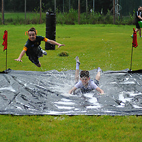 Cillian Joyce skates along showing them how to do it ., St Senans Rugby, Family Fun Day