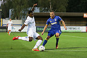 Swansea City U23 defender Tyler Reid (47) clears before AFC Wimbledon midfielder Dean Parrett (18) during the EFL Trophy match between AFC Wimbledon and U23 Swansea City at the Cherry Red Records Stadium, Kingston, England on 30 August 2016. Photo by Stuart Butcher.