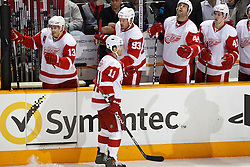 November 30, 2010; San Jose, CA, USA; Detroit Red Wings right wing Daniel Cleary (11) is congratulated by left wing Johan Franzen (93) after scoring a goal against the San Jose Sharks during the first period at HP Pavilion. Mandatory Credit: Jason O. Watson / US PRESSWIRE