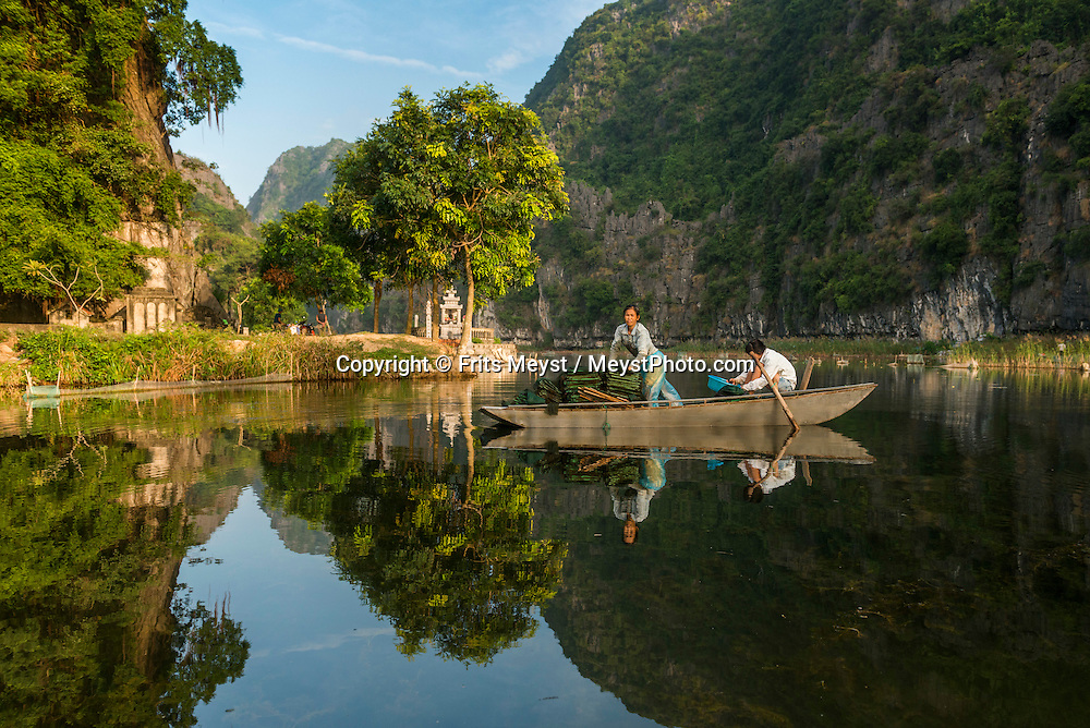 Ninh Binh, Vietnam, November 2016.  Ninh Binh is a good base for exploring the best Vietnamese limestone scenery, such as Tam Coc.  Vietnam is a popular Asian travel destination for tourists and travelers. Photo by Frits Meyst / MeystPhoto.com