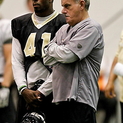 July 26, 2012; Metairie, LA, USA; New Orleans Saints assistant head coach and linebackers coach Joe Vitt talks with safety Roman Harper (41) during the first day of of training camp at the team's indoor practice facility. Mandatory Credit: Derick E. Hingle-US PRESSWIRE