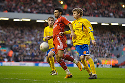 LIVERPOOL, ENGLAND - Saturday, January 26, 2008: Liverpool's Jermaine Pennant and Havant and Waterlooville's Alfie Potter during the FA Cup 4th Round match at Anfield. (Photo by David Rawcliffe/Propaganda)