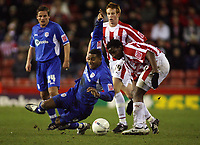 Photo: Paul Thomas.<br /> Stoke City v Millwall. The FA Cup. 05/01/2007.<br /> <br /> Marvin Elliot (Blue) of Millwall is fouled by Vincent Pericard (R).