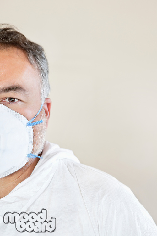 Cropped image of a male worker wearing a protective mask