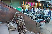Indian beggar at muslim Meena Bazar, in Old Delhi, India