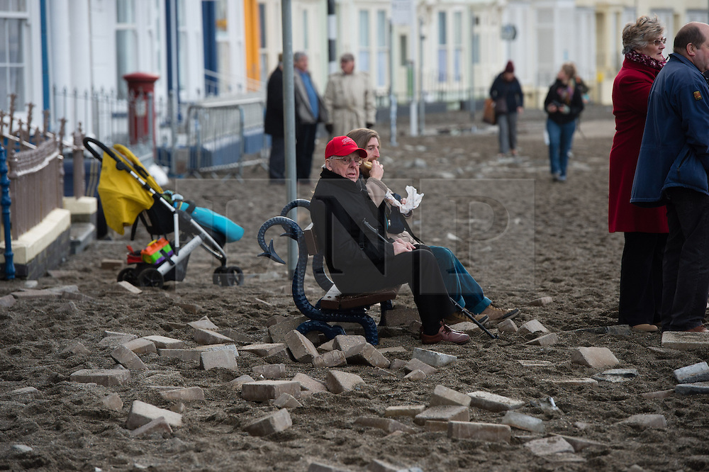&copy; London News Pictures. 07/01/2014. Aberystwyth, UK.<br /> Workmen have now begun the long process of clearing debris and damaged on the seafront at Aberystwyth, Wales, caused by a storm which battered the East coast of the UK and Ireland. Photo credit: Keith Morris/LNP