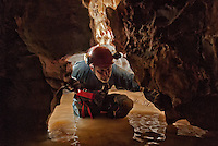 Low section of passage in a wet Arkansas cave.