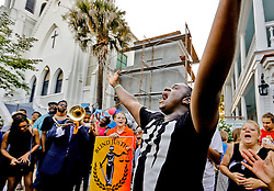Michael Weeks, of North Charleston, leads an impromptu praise and worship service in front of Emanuel AME Church Saturday, June 20, 2015 in Charleston. Weeks said he came to pay his respects and felt led to sing and said he was soon joined by others. Paul Zoeller/Staff