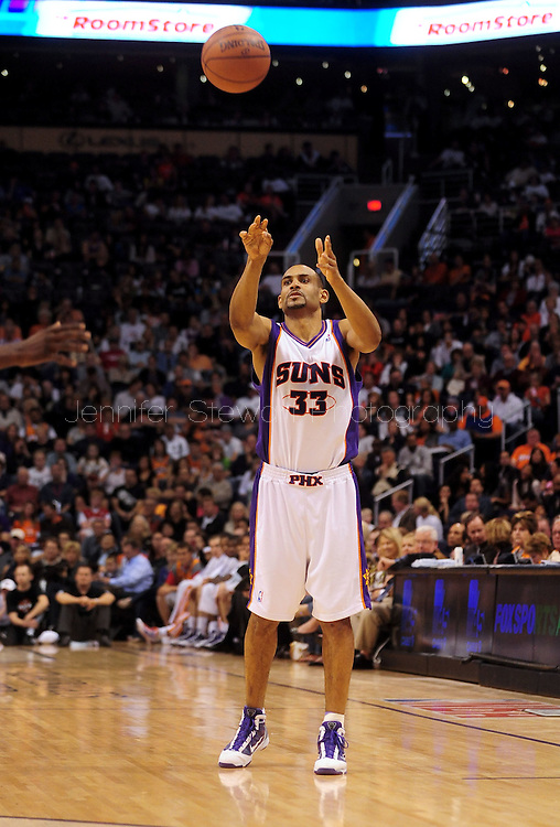 Mar. 14 2010; Phoenix, AZ, USA; Phoenix Suns forward Grant Hill (33) makes a pass in the second half at the US Airways Center. The Suns defeat the Hornets 120 to 106. Mandatory Credit: Jennifer Stewart-US PRESSWIRE.