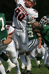 22 October 2005: Thunder Andy Studebaker extends to attempt to block a pass by the Titans Tom Kudyba. Kudyba gets hit by the Thunders Scott Ast as he lets go the pass. The Illinois Wesleyan Titans posted a 23 - 14 home win by squeeking past the Thunder of Wheaton College at Wilder Field (the 5th oldest collegiate field in the US) on the campus of Illinois Wesleyan University in Bloomington IL