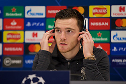 LIVERPOOL, ENGLAND - Tuesday, November 26, 2019: Liverpool's Andy Robertson listens to a translation on a set of headphones during a press conference at Anfield ahead of the UEFA Champions League Group E match between Liverpool FC and SSC Napoli. (Pic by David Rawcliffe/Propaganda)