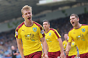 Burnley defender Ben Mee (6) scores a goal and celebrates to make the score 1-3 during the Sky Bet Championship match between Huddersfield Town and Burnley at the John Smiths Stadium, Huddersfield, England on 12 March 2016. Photo by Simon Davies.