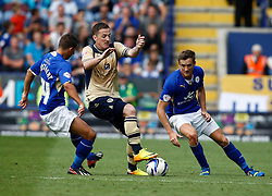 Leeds United's Ross McCormack battles with Leicester City's Anthony Knockaert and Leicester City's Andy King  - Photo mandatory by-line: Matt Bunn/JMP - Tel: Mobile: 07966 386802 11/08/2013 - SPORT - FOOTBALL - King Power Stadium - Leicester -  Leicester City v Leeds United - Sky Bet Championship
