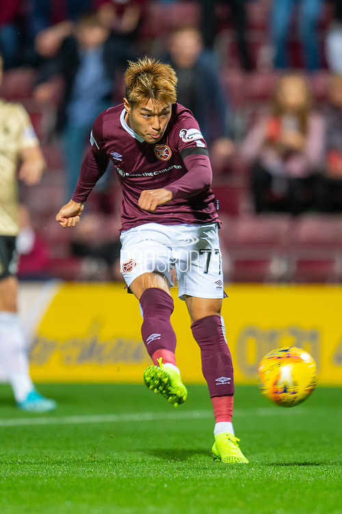 Ryotaro Meshino (#77) of Heart of Midlothian FC takes a shot at goal during the Betfred Scottish Football League Cup quarter final match between Heart of Midlothian FC and Aberdeen FC at Tynecastle Stadium, Edinburgh, Scotland on 25 September 2019.