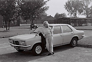 Woman with her first car, Norwich, UK, 1985