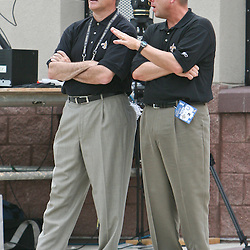 26 August 2006: New Orleans Saints head coach and General Manager Mickey Loomis talk prior to kickoff of a NFL preseason game between the Indianapolis Colts against the New Orleans Saints at Veterans Memorial Stadium in Jackson, Mississippi.