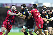 Don Armand of Exeter Chiefs is tackled as he charges forward during the Aviva Premiership match between Exeter Chiefs and Harlequins at Sandy Park, Exeter, United Kingdom on 19 November 2017. Photo by Graham Hunt.