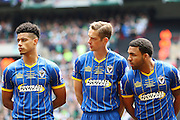 Lyle Taylor forward for AFC Wimbledon (33), Paul Robinson defender for AFC Wimbledon (6) Andy Barcham midfielder for AFC Wimbledon (17) before the Sky Bet League 2 play off final match between AFC Wimbledon and Plymouth Argyle at Wembley Stadium, London, England on 30 May 2016. Photo by Stuart Butcher.