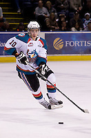 KELOWNA, CANADA, DECEMBER 27:Filip Vasko #10 of the Kelowna Rockets skates with the puck against the Spokane Chiefs at the Kelowna Rockets on December 7, 2011 at Prospera Place in Kelowna, British Columbia, Canada (Photo by Marissa Baecker/Getty Images) *** Local Caption ***