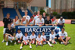 Hong Kong, China - Wednesday, July 25, 2007: Liverpool, Fulham and Portsmouth player pose for a photograph during a coaching session with local children at the Siu Sai Wan Sports Ground in Hong Kong. Players include Andriy Voronin, Jamie Carragher, Jermaine Pennant, Momo Sissoko, Sami Hyypia,Yossi Benayoun, David James, Sol Campbell and Matthew Taylor (Photo by David Rawcliffe/Propaganda)